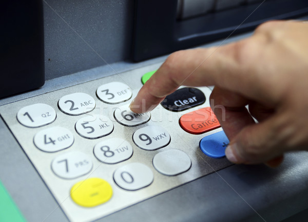 Enter password in the ATM machine concept of banking and security Stock photo © johnkwan