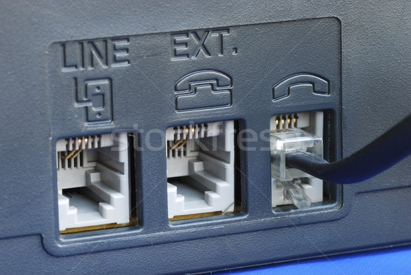 Line connectors at the back of a fax machine isolated on blue Stock photo © johnkwan