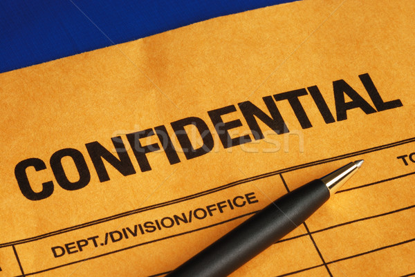 Pen on the confidential envelope isolated on blue Stock photo © johnkwan