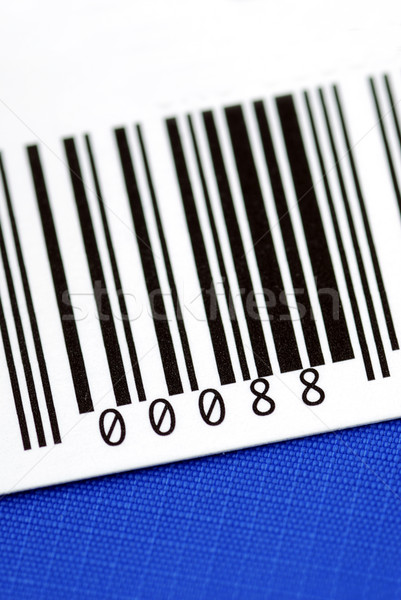 Close up view of the bar code isolated on blue Stock photo © johnkwan