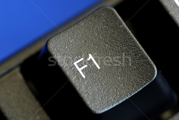 The F1 key represents Help or Assistance isolated on blue Stock photo © johnkwan