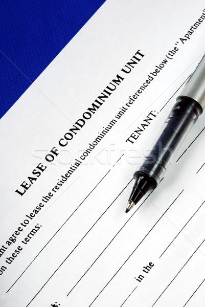 Lease of condominium unit isolated on blue Stock photo © johnkwan