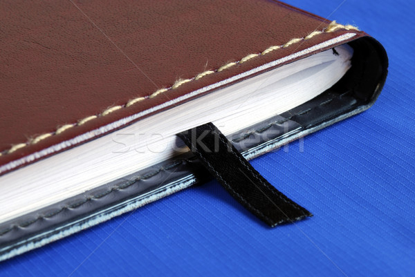 Brown notebook with a black bookmark isolated on blue Stock photo © johnkwan