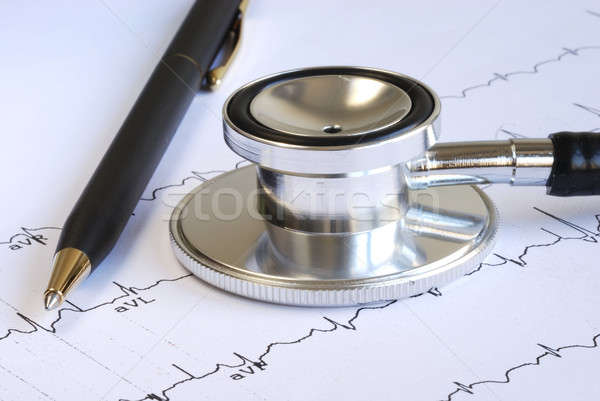 A stethoscope and a pen on the top of the EKG graph Stock photo © johnkwan