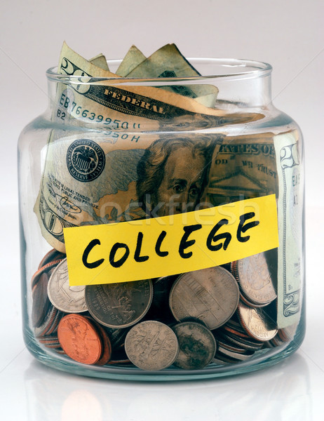 "A lot of money in a glass bottle labeled ""College"" Stock photo © johnkwan"