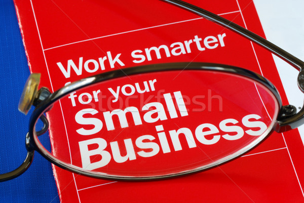 Focus on banking with Small Business isolated on blue Stock photo © johnkwan