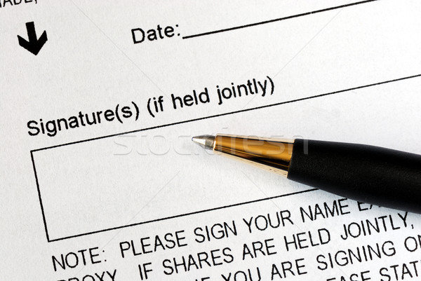 Sign a legal document with a pen Stock photo © johnkwan