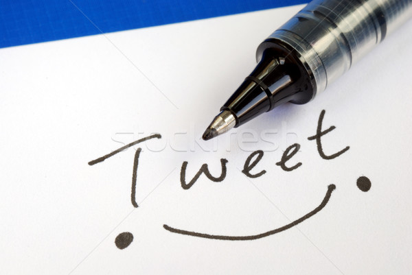 Write the word Tweet and draw a happy smile Stock photo © johnkwan