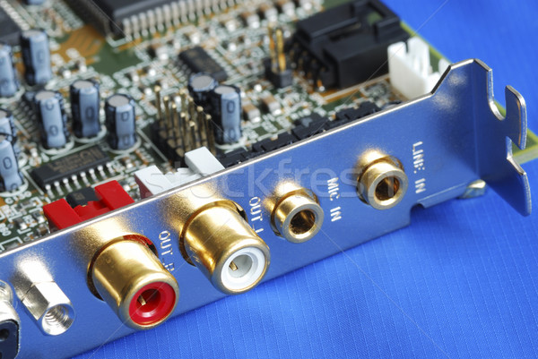 Close up view of a sound card isolated on blue Stock photo © johnkwan