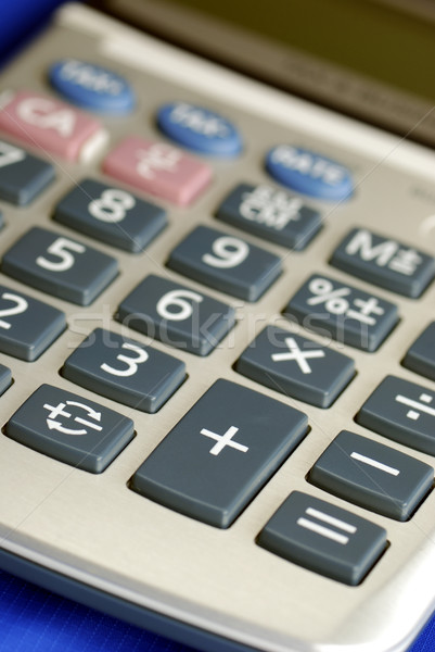 Close up view of a calculator isolated on blue Stock photo © johnkwan