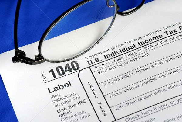 Stock photo: Working on the United States Income Tax 1040