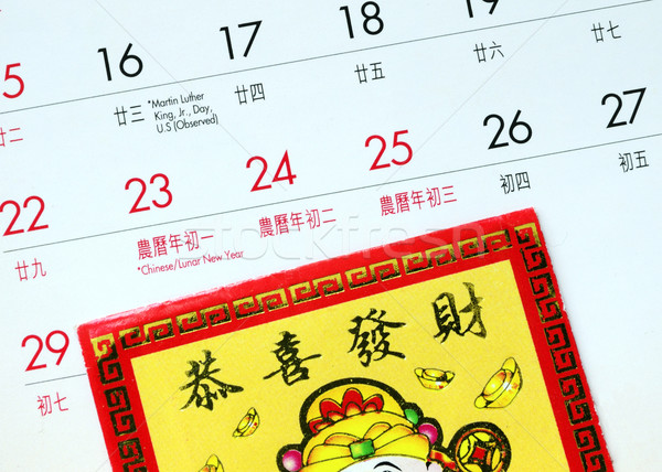 Chinese New Year marked on the calendar and a red lucky-money envelope Stock photo © johnkwan