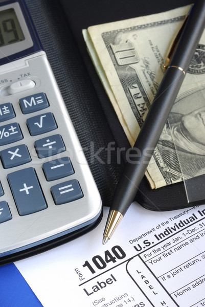 Calculate the tax in the income tax return isolated on blue Stock photo © johnkwan