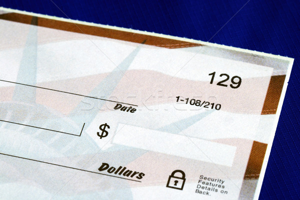 Write the dollar amount on the check isolated on blue Stock photo © johnkwan