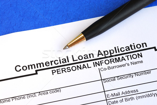 Complete the commercial loan application isolated on blue Stock photo © johnkwan
