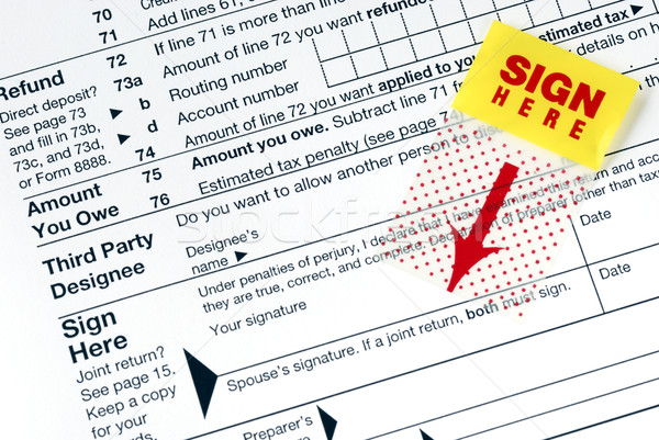 Stock photo: Remember to sign the tax return before you mail