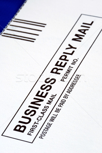 Close-up view of a Business Reply Mail isolated on blue Stock photo © johnkwan