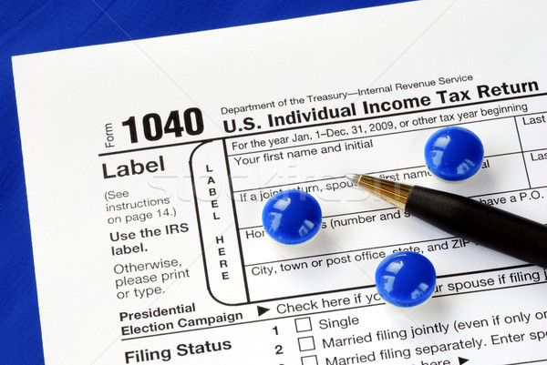 Stress and headache in filing the income tax return Stock photo © johnkwan