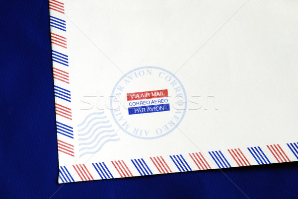 Part of the airmail envelope isolated on blue Stock photo © johnkwan