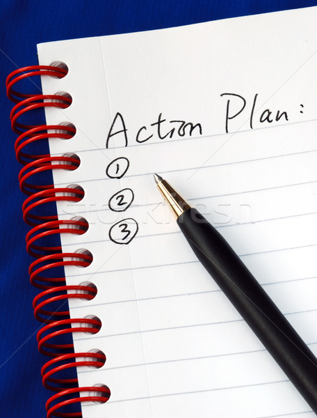 Prepare the action plan in a writing pad isolated on blue Stock photo © johnkwan