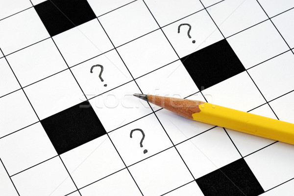 Crossword puzzle with many question marks concepts how to solve the problem Stock photo © johnkwan