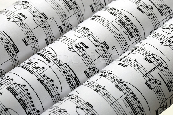 Stock photo: Three music sheets on a row isolated in white