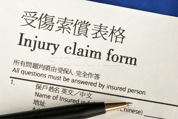 Fill in the injury claim form concepts of insurance Stock photo © johnkwan