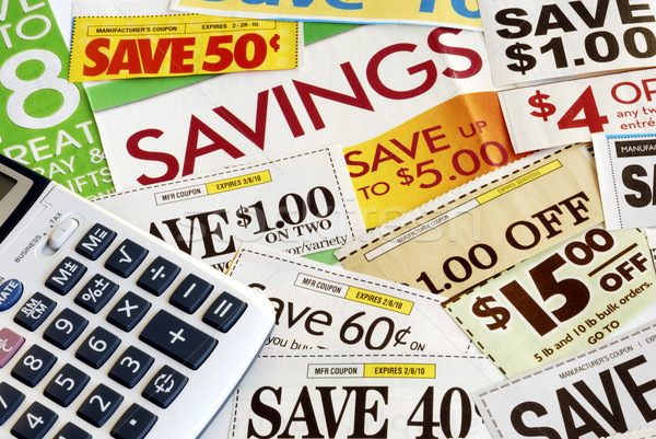 Calculate how much we save by clipping coupons Stock photo © johnkwan