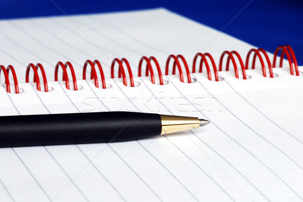 The spiral note pad with a pen and glasses Stock photo © johnkwan