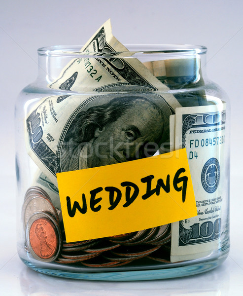 "A lot of money in a glass bottle labeled ""Wedding"" Stock photo © johnkwan"