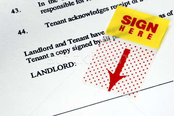 The sign-here sticker on the rental contract Stock photo © johnkwan