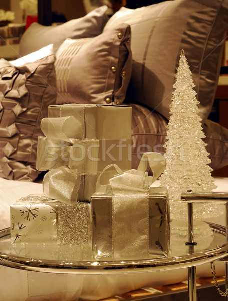Wrapped Christmas gifts on a glass table next to the bed (converted to monotone) Stock photo © johnkwan