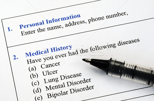 Filling the patient personal information and medical history questionnaire Stock photo © johnkwan