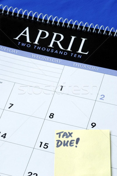 April 15th is the due day for income tax returns isolated in blue Stock photo © johnkwan