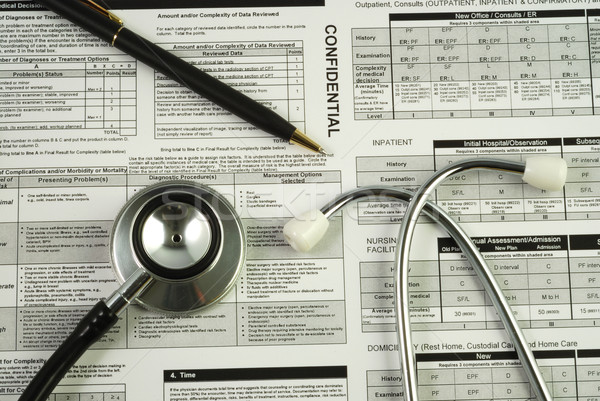 A stethoscope on the top of a medical utilization document concepts of optimizing the medical benefi Stock photo © johnkwan