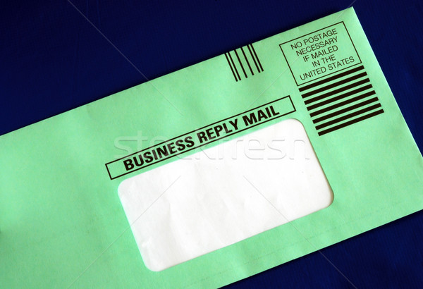 Send out a business reply letter with the address part blanked out for your text isolated on blue Stock photo © johnkwan