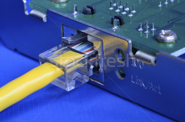Ethernet cable on the network card concept of communication and internet Stock photo © johnkwan