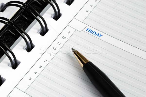 Write some notes on the day planner  Stock photo © johnkwan