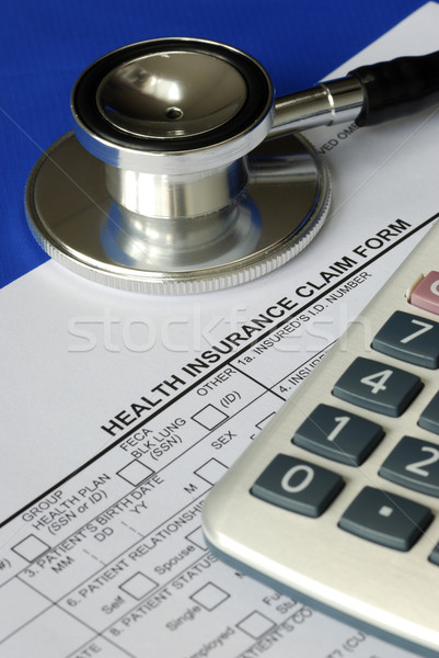 Rising medical cost in the United States isolated on blue Stock photo © johnkwan