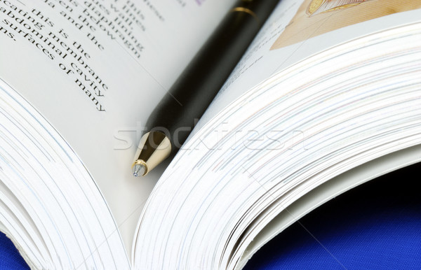 Open book with a pen isolated on blue Stock photo © johnkwan