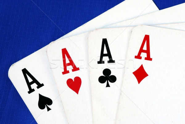 Four ace play cards isolated on blue Stock photo © johnkwan