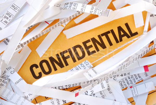 The word Confidential surrounded by some shredded papers Stock photo © johnkwan