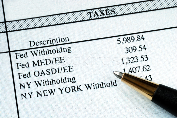A list of withholding taxes from the pay stuff Stock photo © johnkwan