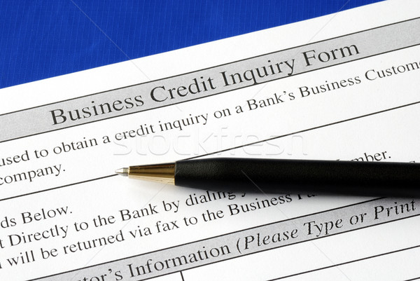 Complete the credit inquiry form isolated on blue Stock photo © johnkwan