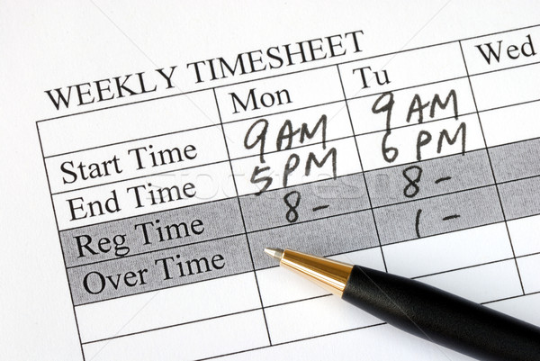 Filling the weekly time sheet for payroll Stock photo © johnkwan