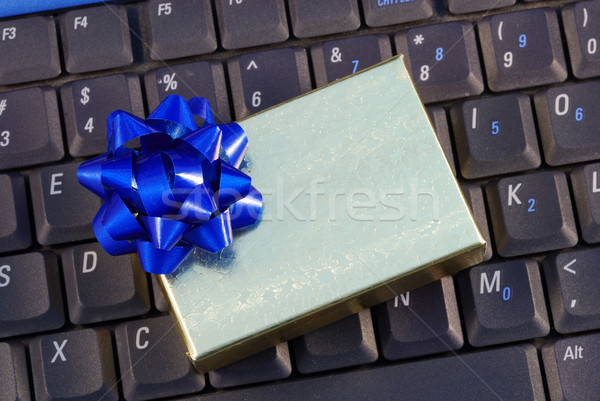Stock photo: Holiday gift box on a keyboard concepts of holiday online shopping
