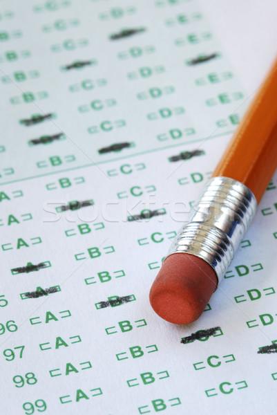 Fill the computer grade sheet with the pencil Stock photo © johnkwan
