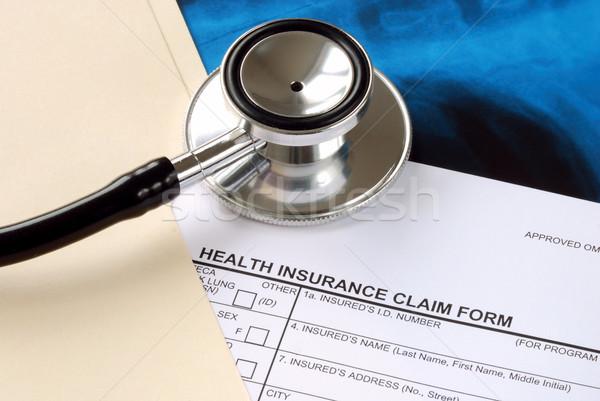 A stethoscope on the medical claim form Stock photo © johnkwan