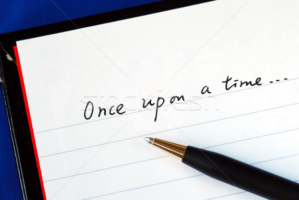 Begin writing the story with the phrase 'Once upon a time' isolated on blue Stock photo © johnkwan
