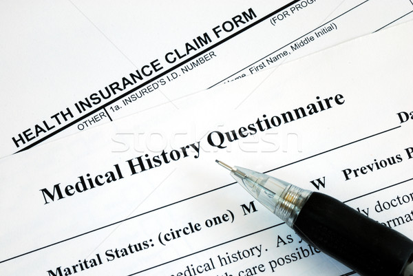 Medical claim form and patient medical history questionnaire Stock photo © johnkwan